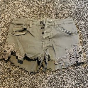 Green distressed high rise Jean shorts